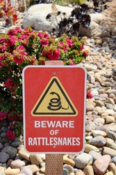 A beware of rattlesnakes warning sign.