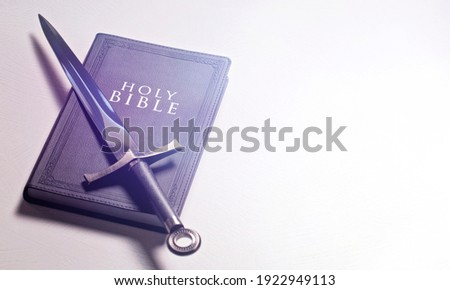 A Bible and Sword on a Bright White Background Photo stock ©