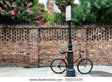 A Bicycle Locked To A Pole In The New Orleans French Quarter - stock photo