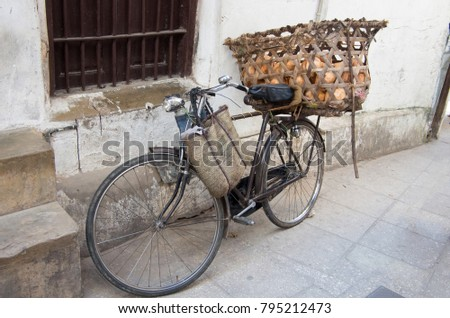a bicycle with a basket for...
