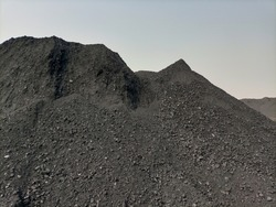 A big black heap of coal from mine