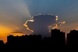 A big city silhouette against the background of the evening sky. Silhouette of high-rise buildings against the setting sun