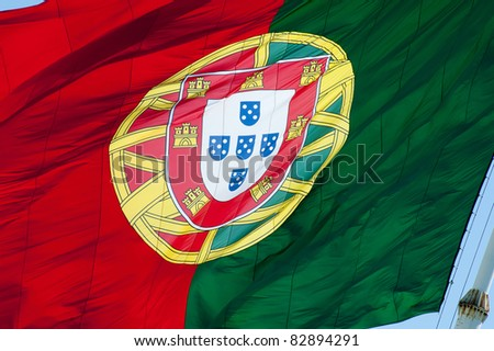 A big colored flag of the Portugal