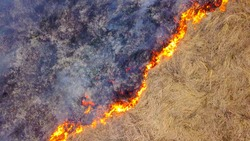 A big fire. The dry grass is burning. much smoke.  Ekaterinburg, Russia, From Dron, HEAD OVER SHOT