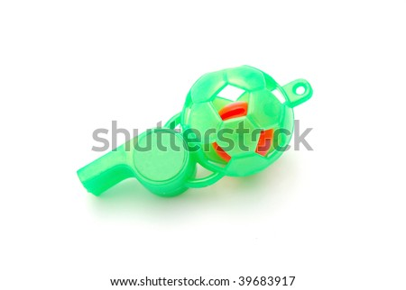 A big green plastic toy whistle for kids isolated on white studio background