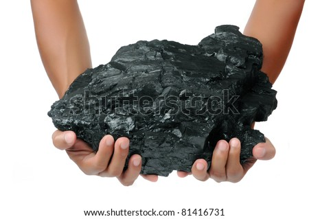 a big lump of coal is held with two hands isolated on white background
