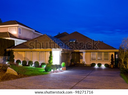 A big luxury house in suburbs at dusk ( night ) in Vancouver, Canada