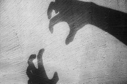 a big monster claw shadow Hallowween concept on wall.