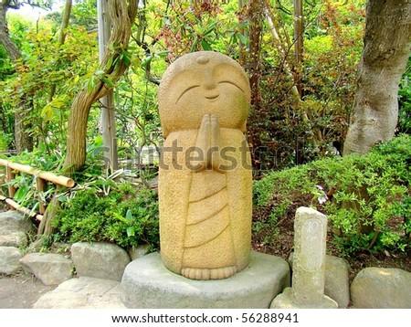 A big Nagomi-Jizo, symbol of relaxation in the Buddhist temple Hasedera, Kamakura, Japan