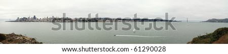 A big panoramic view of the San Fransisco bay area from the pacific side of The Golden Gate in a cloudy day