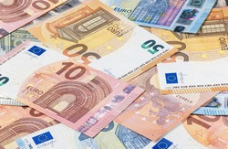 A big pile of euro banknotes. Many Euro bills lie on top of each other. Bunch of money of the European Union. Currency of the united Europe. Cash balance of the European Central Bank or ECB.