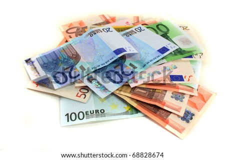a big pile of euro notes on a white background