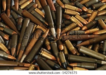 A big pile of various gun bullets