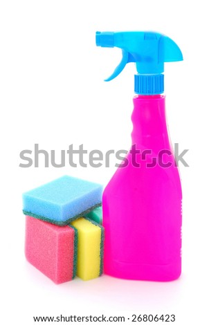 A big pink and blue spray bottle with colorful kitchen sponges for spring cleaning isolated on white studio background.