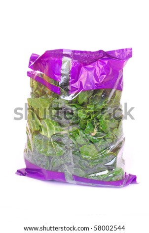 A big plastic bag full of fresh healthy organic shredded and washed spinach. Image isolated on white studio background.