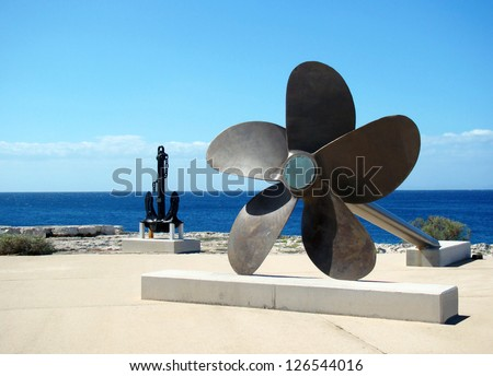 A big propeller and anchor located on the coast, Ciutadella, Menorca