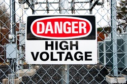 A big red, white and black danger warns trespassers away from this substation.
