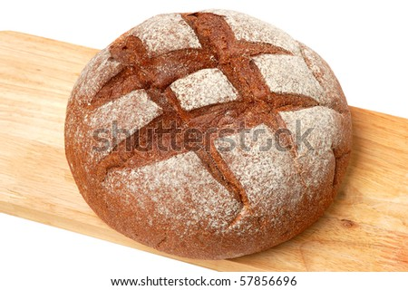 A big round homemade whole wheat bread on a white background