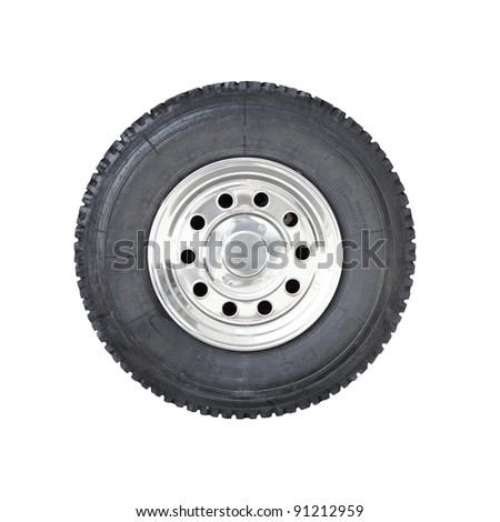 a big rubber tire mounted on a chrome plated wheel hub of a truck isolated against white stock. Black Bedroom Furniture Sets. Home Design Ideas