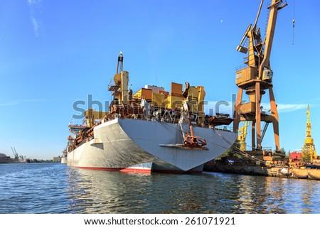 A big ship loading cargo at port of Gdansk, Poland.