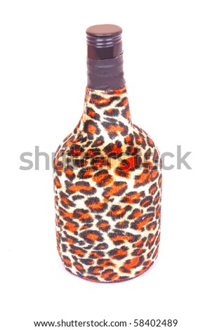 A big Whiskey bottle with African leopard skin pattern. Image isolated white studio background.