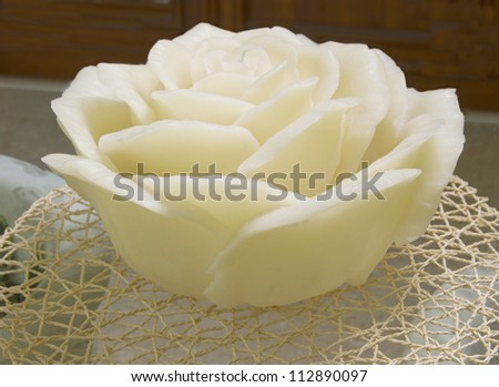 A big white candle in shape of a rose