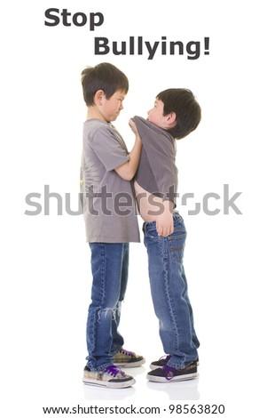 A bigger boy bullying a smaller boy