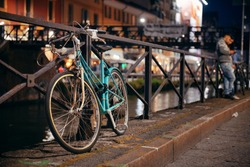 A bike park at waterfront of Naviglio Grande canal in Milan, Italy.