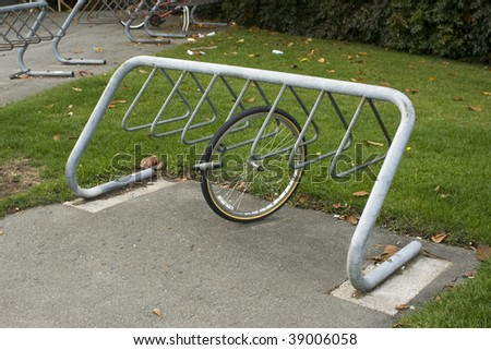 A bike rack with a wheel locked to it