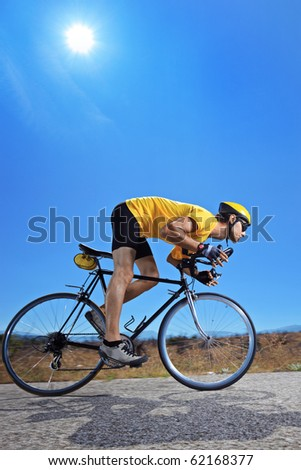 A biker riding a bike on an open road - stock photo