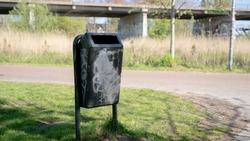 a bin with graffiti on it