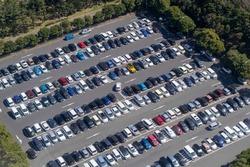 A bird's-eye view of a full outdoor parking lot