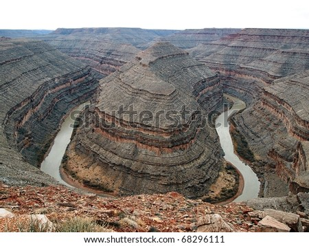 A bird's eye view of a river canyon with a 180 degree turn.