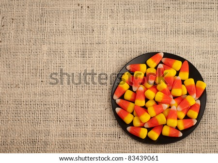 A Bird's Eye View of Candy Corn in a Dish for Halloween or Thanksgiving Themed Invitation or Card with Area for Your Words