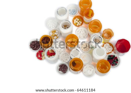 A bird's eye view of multiple medicine bottles and pills