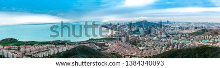 A bird's eye view of Qingdao coastline and urban skyline #1384340093