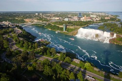 A bird's-eye view of the American Falls of the Niagara Falls and the city of Niagara Falls from the Canada side in summer