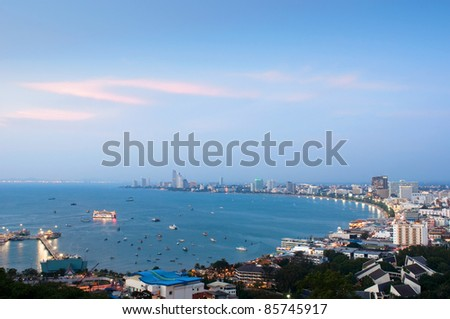 A bird's view over the beach of Pattaya city in Chonburi, Thailand just after sunset with a deep blue sky.