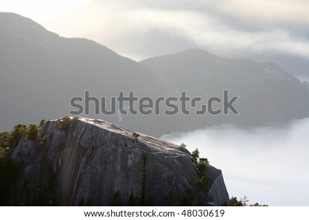 A bird view from the peak of Stawamus Chief in BC, Canada in  sunset.
