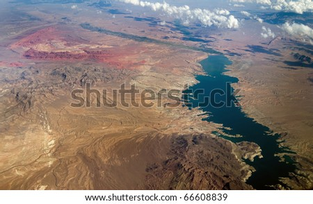 A birds eye aerial view of an unpopulated area of mountains and a river system in the United States of America.