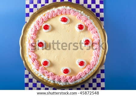 A birthday cake with strawberry and lemon cream with cherries on top