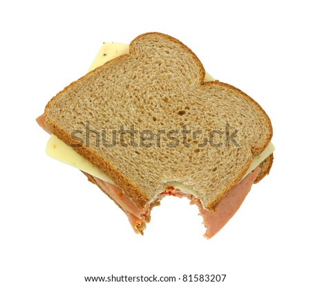 A bitten wheat bread sandwich with pickle and pimento and pepper jack cheese on a white background.