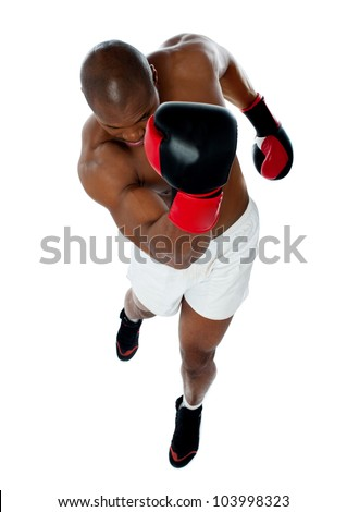 A black african american man athletic boxer with boxing gloves punching in upwards direction