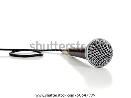 A black and silver microphone on a white background