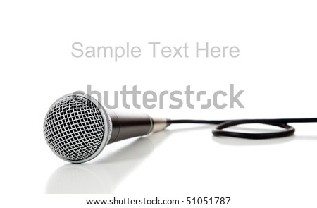 A black and silver microphone on a white background with copy space