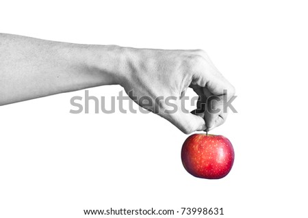 a black and white hand holding a red apple
