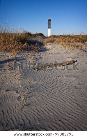A Black and White Lighthouse on the Beach