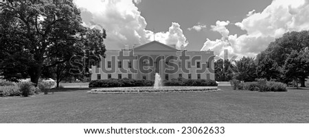 A black and white panorama of the north face of the White House in Washington, DC.