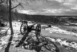 A black and white photo of a cannon on Little Round Top at the Gettysburg National Military Park in Pennsylvania where union and confederate soldiers battled in July of 1863.