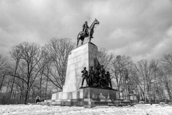 A black and white photo of The State of Virginia Monument with General Robert E. Lee on his horse Traveler at the Gettysburg National Military Park on the field of Pickett's Charge.